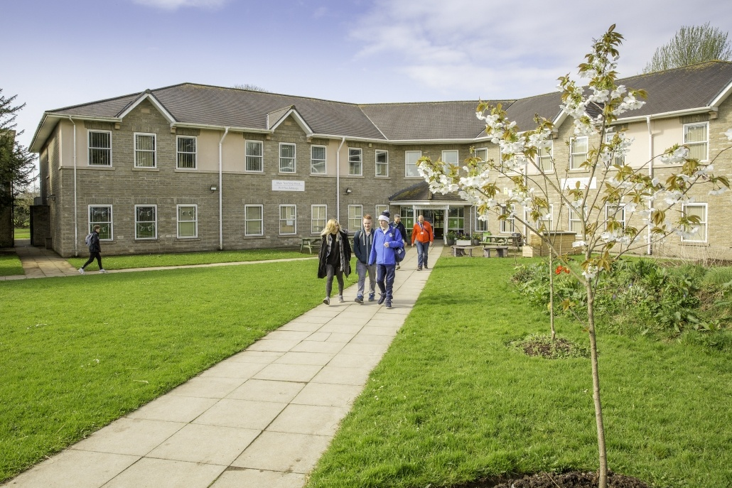 The lawns and path outside reception at Pencoed Campus