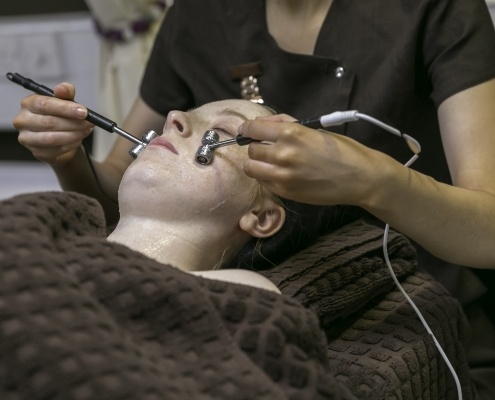Customer receiving facial treatment