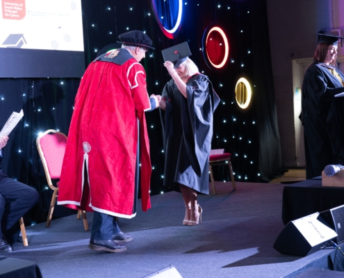 Student acknowledged at stage at our graduation ceremony