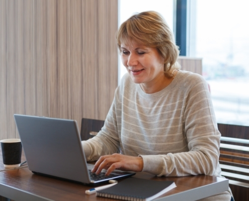 Lady using a laptop at home