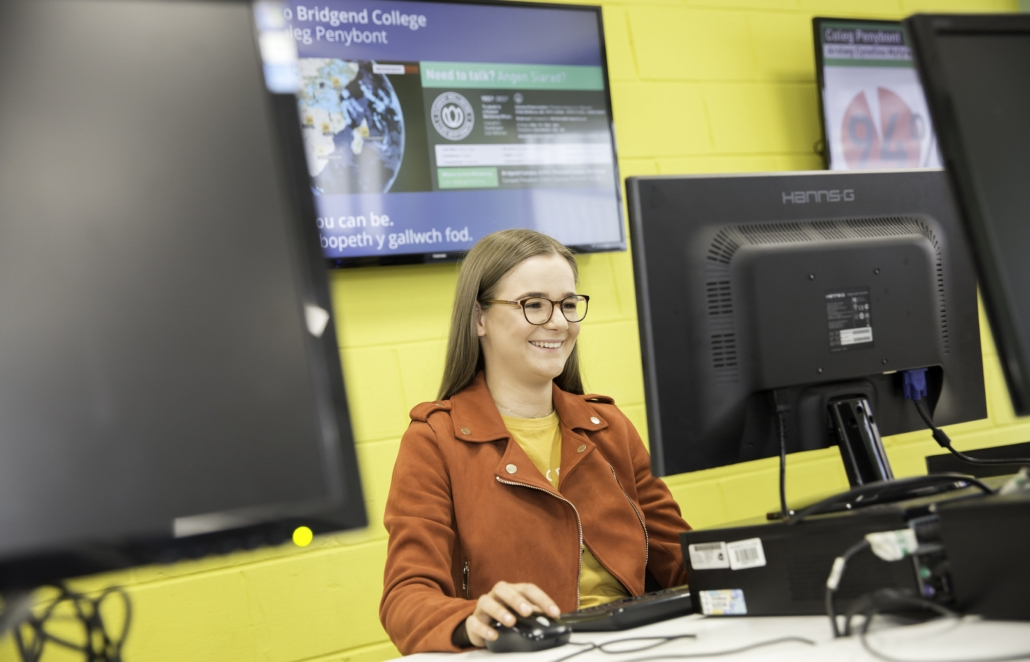 Happy student using a computer