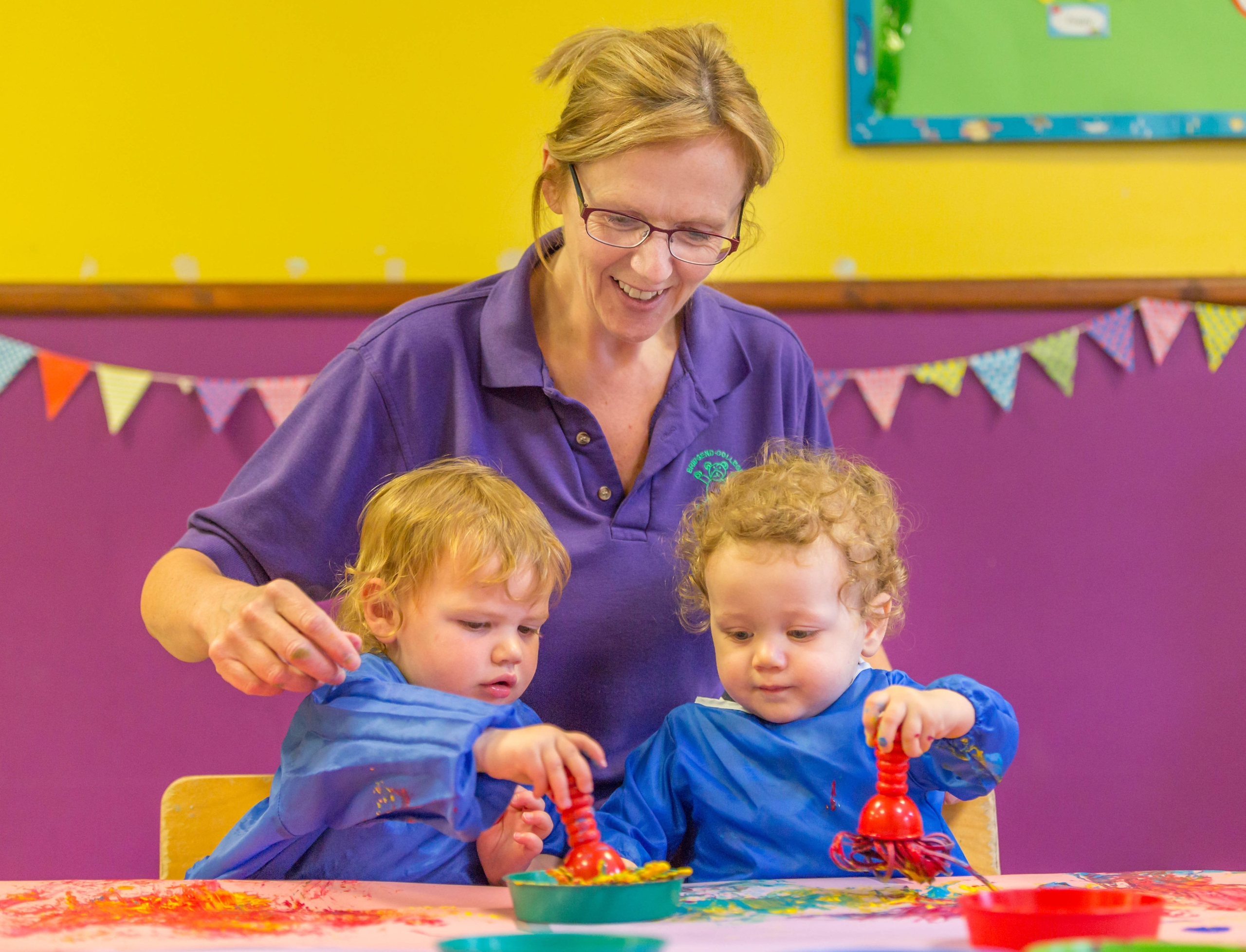 2 children with nursery nurse in Bridgend College Day Nursery